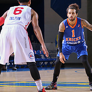 Westchester Knicks Guard JORDON CRAWFORD (1) attempts to pass the ball as Delaware 87ers Guard Gary Talton (6) defends in the first half of a NBA D-league regular season basketball game between the Delaware 87ers and the Westchester Knicks  Saturday Dec, 26, 2015 at The Bob Carpenter Sports Convocation Center in Newark, DEL