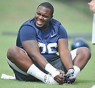 Center A.J. Hawkins stretches as the University of Mississippi began football practice in Oxford, Miss. on Saturday, August 6, 2011. The team began practicing outside before lightning in the area sent them indoors for practice. (AP Photo/Oxford Eagle, Bruce Newman)