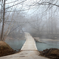 Beech Creek River flowed under a concrete bridge in the morning fog in Wild Cat, Ky., on 3/19/10. Photos by David Stephenson