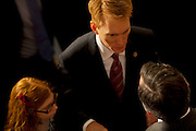 Republican congressmen and family members mingle on the floor prior to being sworn in to office at the United States Capital in Washington, DC on Wednesday, January 5, 2011.