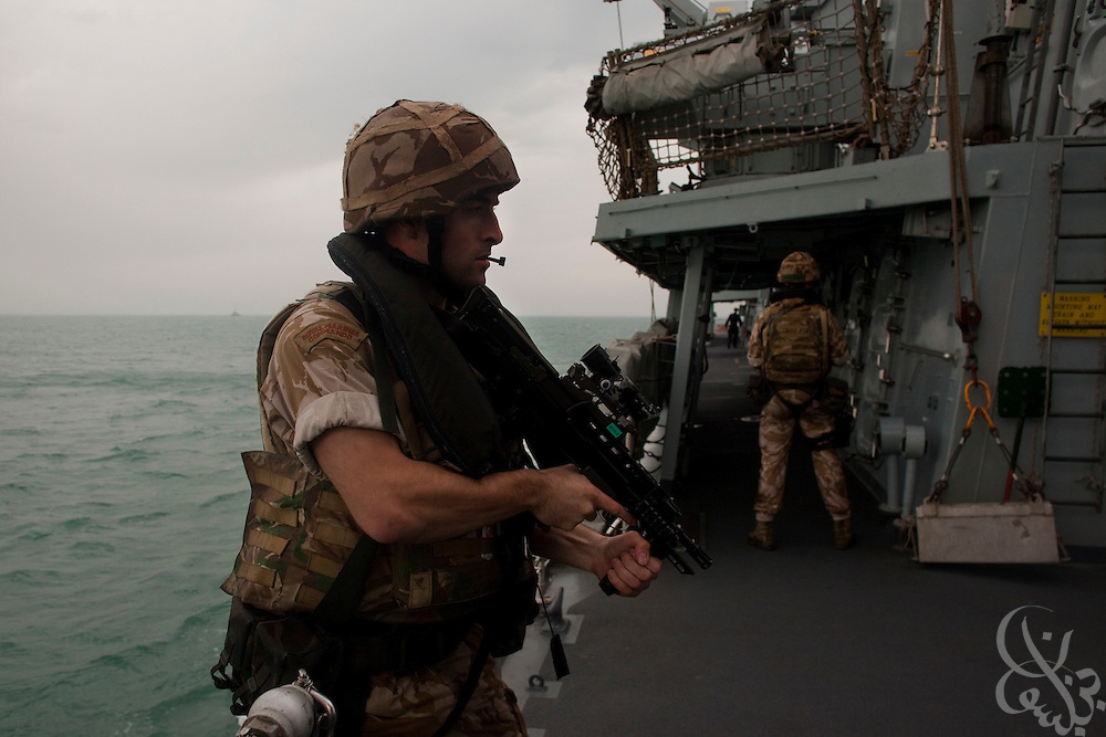"UK Royal Marines from the frigate HMS Monmouth take part in a training exercise to simulate the boarding of a potentially hostile ship February 03, 2010 during their current mission patrolling a nautical exclusion zone protecting the Al Basrah Oil Terminal (ABOT) 50 kilometers off the Iraqi coast in the Northern Arabian Gulf. The Monmouth, nicknamed the ""Black Duke"", is part of the US and UK  Combined Joint Task force Iraq Maritime which currently provides security for ABOT due to the extreme importance of the terminal to Iraqs oil infrastructure and economy.  (Photo by Scott Nelson/Agentur Focus)"