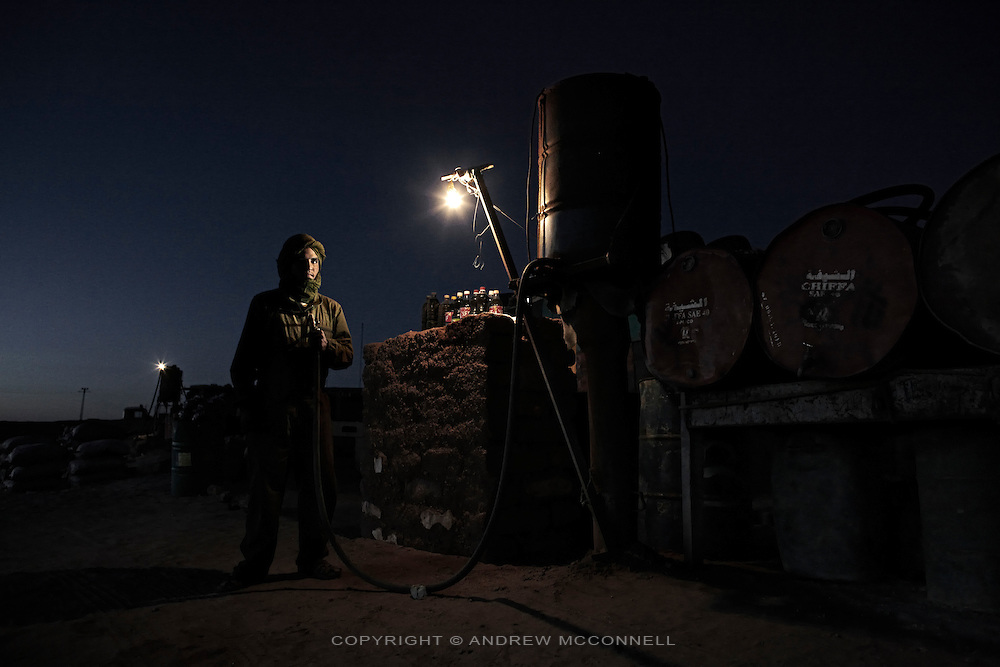 Mohammen Sheikh Salek, 30. Gas station attendant, pictured in Rabouni refugee camp, Algeria...I was born in Auserd [refugee camp] in 1989. I liked Auserd but always felt a little homeless because it was a refugee camp. It was hard to live there with sandstorms and the sun. I always felt like I had lost something. Later we moved to El Aaiun camp but I wished I was in El Aaiun city. After I left school I spent a lot of time looking for a job but this is the only job I could find. Time forces me to do this. We get gasoline from Algeria, I make about two Dinar [EUR0.02] on every litre. Since the ceasefire many people have cars, they go to Spain and other countries and come back with cars. Maybe half the people have cars, the best are the Land Rovers. They are great for the desert and the Saharawi mechanics know them very well. ..This is only a job to pass the time. I am a soldier waiting for war. I trained with the Polisario for one year and now I am a trainer for young Saharawi in the use of weapons. All young Saharawi know how to use a weapon. I refuse the ceasefire, it is blocking our chance to be free. The Polisario except it but I don't know why. I believe they will find a solution. In the next meetings with Morocco if they do not come back with a solution we must go back to war.