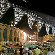 The area around Imam Hussein Holy Shrine come alive as night falls in Karbala, Iraq, Monday, July 21, 2003. Imam Hussein, the grandson of the Prophet Mohammad, was killed in Karbala and his head was taken to Cham, Syria.
