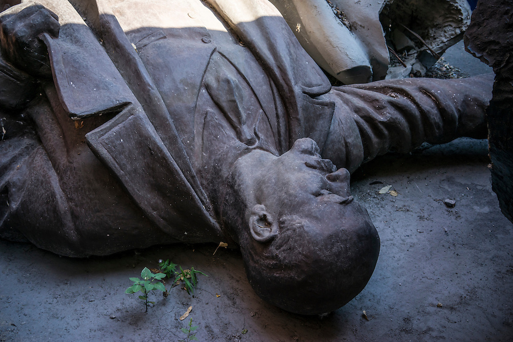 MARIUPOL, UKRAINE - AUGUST 31, 2015: A statue of Vladimir Lenin lies on the ground after being removed from public display in Mariupol, Ukraine. Since the Maidan protests, many Lenin statues were toppled either by pro-Ukrainian activists in a symbolic break with their Communist past and Russian ties, or else to comply with a  recent law which bans the display of Communist or Nazi symbols. CREDIT: Brendan Hoffman for The New York Times