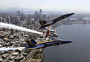 Always a thrill at Seafair time, the Blue Angels fly over downtown Seattle and Elliott Bay. <br />