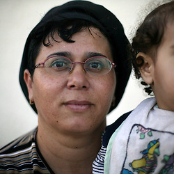 """Aliza Cohen, 40, a teacher who has lived in the Gush Katif settlements for 20 years, is seen in Gaza, Palestinian Territories, Nov. 4, 2004. When asked her thoughts about leaving the settlements, Cohen responded, """"My husband was moved from Egypt and now we are being asked to move again. It's very hard. We have built a beautiful place out of nothing. We built a family and life here. I pray that God will help us."""" Israel's parliament recently supported compensation payments for Jewish settlers leaving the Gaza Strip, in a vital vote for Prime Minister Ariel Sharon's plan to evacuate the occupied territory."""