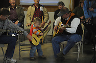 Bo Ware of Batesville with grandson Carson was among musicians playing at Blcackjack Connection at Blackjack Presbyterian Church near Sardis Lake on Monday, March 21, 2010.