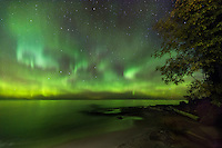 The Aurora Borealis dances across the night sky along the Lake Superior shore - Michigan's Western Upper Peninsula
