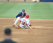 Mississippi's Austin Anderson (8) tags out Arkansas' Bo Bigham (12)  at Oxford-University Stadium in Oxford, Miss. on Sunday, April 22, 2012. Arkansas won 11-3.
