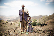 Farmer Kasa Kebde, 36, and his daughter Bri Kasa, 6 looking after their cattle in Adi Sibhat, Tigray, Ethiopia.
