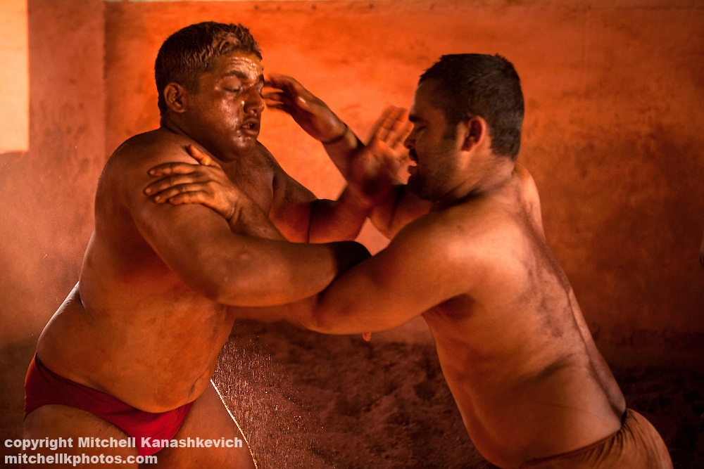 Kusti or Kushti is India's traditional wrestling on soil - an ancient sport which is gradually dying out in most parts of India due to the government's pressures on the traditional Kusti/Kushti schools to abandon ways of the past, embrace international wrestling standards and win medals at the Olympics...Kolhapur is one city where Kusti/Kushti is still thriving. Rural families from the area send their boys to the city's Thalims or Akharas - traditional wrestling schools, where the young men dedicate themselves entirely to the sport. Grueling daily training, strict diet and celibacy for the duration of their careers are necessary if they hope to ever achieve their dream - to become a champion 'pailwan' (wrestler), in front of crowds which can reach as many 20,000 spectators.
