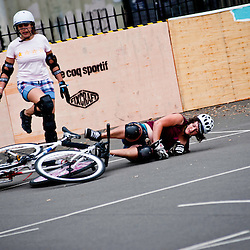 London, UK - 24 August 2012: two participants clash during the Hell's Belles Vol 2, Ladies Bike Polo Tournament in Bethnal Green Gardens.