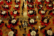Delegates have tea ahead of a plenary session of the Chinese People's Political Consultative Conference, at Beijing's Great Hall of the people Beijing, China, Saturday, March 7, 2009. China's National People's Congress is a largely powerless body but it represents one of the country's last displays of old style communism. Ethnic minority delegates from around the country attend the meetings wearing traditional costumes, a conceit which allows the government to argue that the nation's different cultures co-exist harmoniously. Little is decided at these gatherings though. The NPC functions largely as a rubber stamp body for policies put forward by the Communist party's elite.