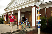 City of Tybee Island employee Todd Smith walks into city hall to check on preparations for Hurricane Matthew, Wednesday, Oct. 5, 2016, on Tybee Island, Ga. (AP Photo/Stephen B. Morton)