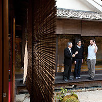 Hugh Montgomery (on right) of The Independent,, Kaoru Yamamoto (centre, chef at SO Restaurant London) and Tetsuro Hama (left of image)- owner of SO Restaurant London, dining in Kanga-an temple, a restaurant serving Shojin-ryori cuisine (eaten mainly by Buddhist followers), in Kyoto, Japan, on Friday 13th January 2012.