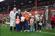 Blackpool FC Legends Jock Dodds,Jackie Mudie and Sir Stanley Matthews with young fans prior to the Division 4 fixture against Lincoln City