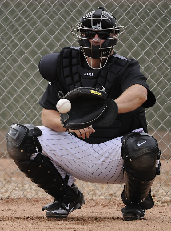 GLENDALE, AZ - FEBRUARY 26:  A.J. Pierzynski #12 of the Chicago White Sox catches during a spring training workout on February 26, 2011 at Camelback Ranch in Glendale, Arizona. (Photo by Ron Vesely)