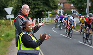 Marshalls encourage cyclists as they ride through the Surrey countryside at Abinger Hammer during the Prudential RideLondon-Surrey 100, Sunday 2nd August 2015. <br /> <br /> Prudential RideLondon is the world&rsquo;s greatest festival of cycling, involving 95,000+ cyclists &ndash; from Olympic champions to a free family fun ride - riding in five events over closed roads in London and Surrey over the weekend of 1st and 2nd August 2015. <br /> <br /> Photo: Christopher Ison for Prudential RideLondon<br /> <br /> See www.PrudentialRideLondon.co.uk for more.<br /> <br /> For further information: Penny Dain 07799 170433<br /> pennyd@ridelondon.co.uk