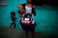 Children stand next to a square where they use to play in the favela of Providencia in Rio de Janeiro, Brazi, February 25, 2015. Photo/Pilar Olivares