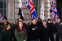 """London, February 8th 2015. Muslims demonstrate outside Downing Street  """"to denounce the uncivilised expressionists reprinting of the cartoon image of the Holy Prophet Muhammad"""". PICTURED: Members of right wing anti-Islamic group Britain First, led by Paul Golding, centre, counter-demonstrate, chanting """"Muhammad is a paedophile!"""""""