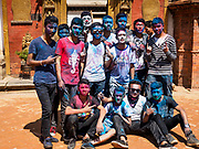 12 MARCH 2017 - BHAKTAPUR, NEPAL: Nepali men covered in Holi powder at a Holi celebration in Bhaktapur. Holi, a Hindu religious festival, has become popular with non-Hindus in many parts of South Asia, as well as people of other communities outside Asia. The festival signifies the victory of good over evil, the arrival of spring, end of winter, and for many a festive day to meet others. Holi celebrations in Nepal are not as wild as they are in India.     PHOTO BY JACK KURTZ