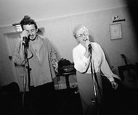 From the Family Gatherings series, 1987-2009<br /> My mother Catherine singing a duet with my brother Declan.