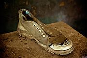 Old tennis shoe. Jaffna homes. 2011