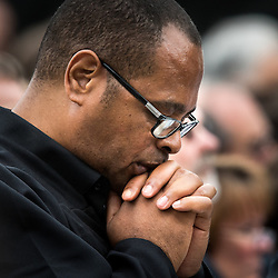 Lisa Johnston | lisajohnston@archstl.org  | Twitter: @aeternusphoto  A man prayed during Mass. Pope Francis closed the 2015 World Meeting of Families with an outdoor Mass celebrated on the Benjamin Franklin Parkway.