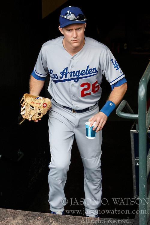 SAN FRANCISCO, CA - OCTOBER 02: Chase Utley #26 of the Los Angeles Dodgers enters the dugout before the game against the San Francisco Giants at AT&T Park on October 2, 2016 in San Francisco, California. The San Francisco Giants defeated the Los Angeles Dodgers 7-1. (Photo by Jason O. Watson/Getty Images) *** Local Caption *** Chase Utley