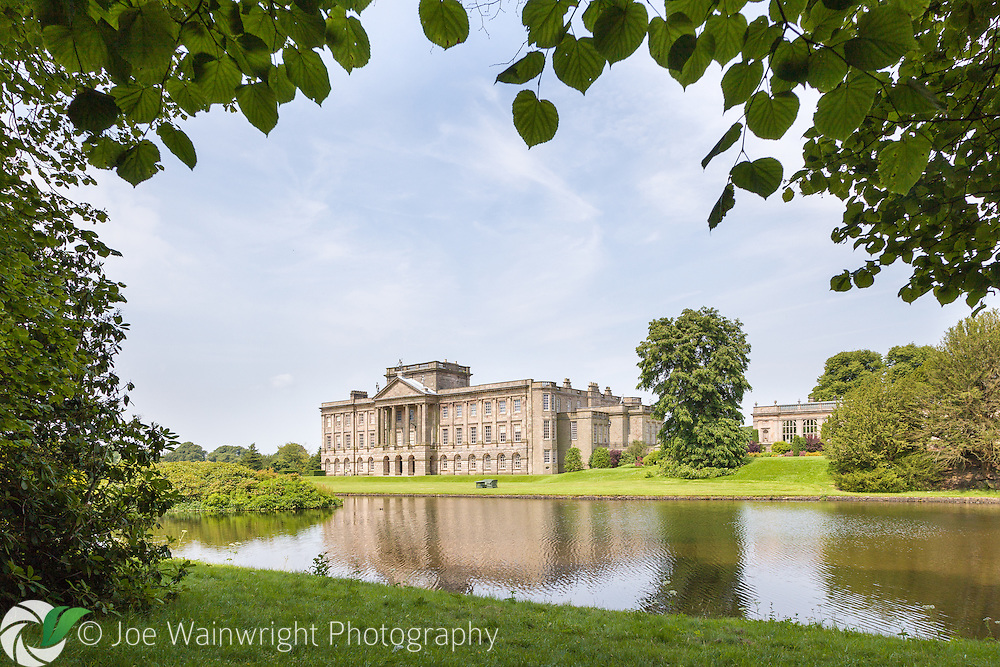 Framed by the leaves of a lime tree, the house at Lyme Park dates in parts from the 16th, 17th, 18th and 19th centuries.