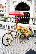 Rickshaw in front of Kaptian Keling Mosque.