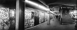 (021208-SWR08.jpg) New York, NY - Circa 1989 -- A Conductor looks out the window of a Graffiti Covered S Train (Grand Street Shuttle)  as it pulls out of the West Fourth Street Subway Station on the IND line.