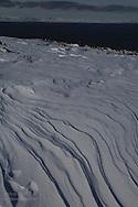 Wind blown snow in April between Longyearbyen and Barentsburg; Svalbard, Norway.