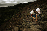 Ametista do Sul, RS, Brazil, 28/02/2008, 13h51: A kid search for rests of amethyst in a mine garbage in the top of a canyon in Ametista do Sul.(photo: Caio Guatelli)