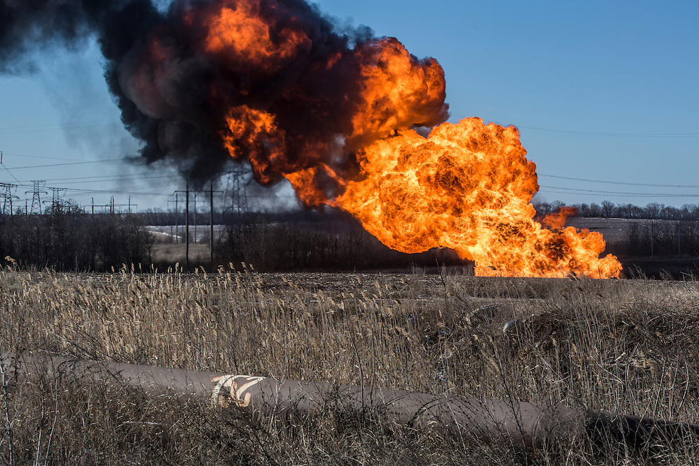 MYRONIVSKYI, UKRAINE - FEBRUARY 17: A gas pipe burns after being struck by shelling on February 17, 2015 in Myronivskyi, Ukraine. A ceasefire agreed to by Ukraine and pro-Russian rebel forces has failed to prevent fighting in the nearby town of Debaltseve, where thousands of Ukrainian troops remain and whom rebels claim to have surrounded. (Photo by Brendan Hoffman/Getty Images) *** Local Caption ***