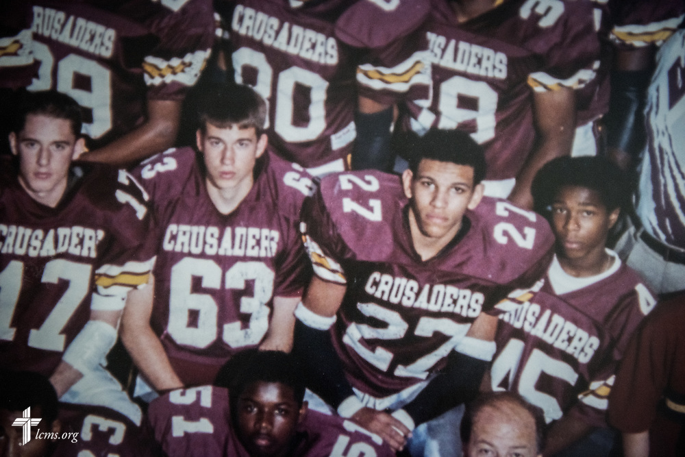 A copy photograph depicting Micah Glenn (27), new national missionary to Ferguson, when he was on the football team at Lutheran High School North, photographed on Wednesday, April 20, 2016, in St. Louis. LCMS Communications/Erik M. Lunsford