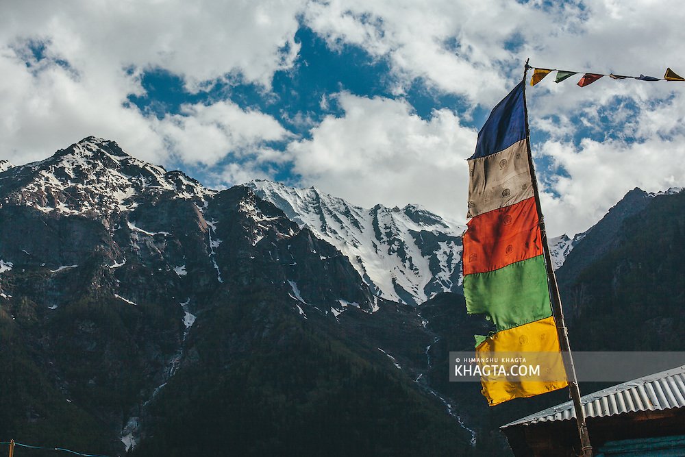 Tibaten flag with the backdrop of the Himalayas at Rakcham