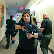 Sergeant Jill Wix (CENTER) carrying a replica swat rifle while participating in a basic formation drill in the course of an Active Shooter workshop Sunday, Mar 16, 2014 Christina Hospital in Newark Delaware.
