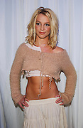 "NEW YORK - FEBRUARY 17:  (TABS OUT) Britney Spears backstage at the first MTV ""TRL Awards"" at the MTV Times Square Studios February 6, 2003 in New York City. Britney co-hosted the show with Carson Daly. (Photo by Frank Micelotta/Getty Images)"