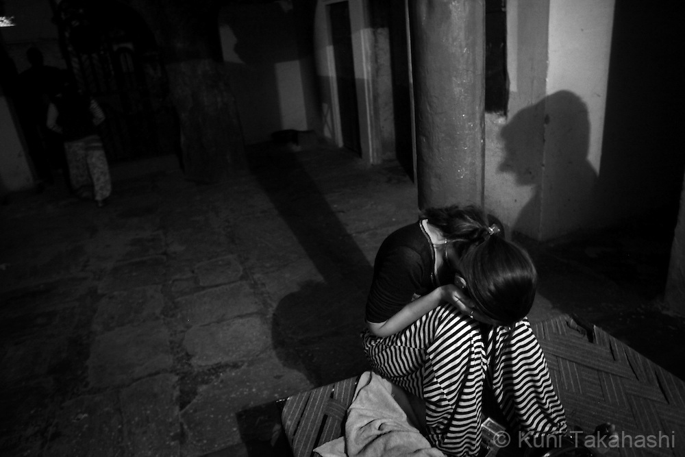 A young prostitute covers her face from camera in Tilawada, a red light district, 30 km west of Jaipur. Preeti, who is from Ingonia, has been in the business over five years. ...