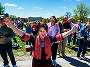 04 MAY 2017 - ST. PAUL, MN: A woman prays during a prayer service at the Minnesota State Capitol. About 200 people gathered on the lawn in front of the Minnesota State Capitol in St. Paul for a noon time prayer service on the National Day of Prayer. Similar services were held across the country.     PHOTO BY JACK KURTZ