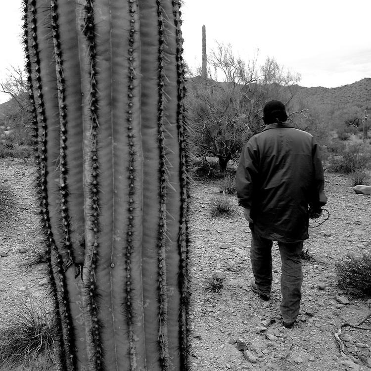 Bobby Parra walks through the desert on Sunday, July 13, 2008 in North Komelik, AZ.