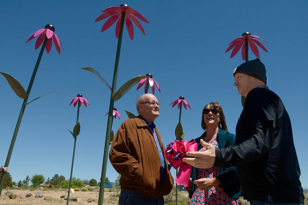 """gbs043017i/RIO-WEST -- Vincent Murphy, Deputy County Manager, Nan Masland, Public Art Project Coordinator, and Bernalillo County Commissioner Lonnie Talbert  visit at the Paradise Hills Community Center after the dedication of the public art sculptures titled """"Coneflowers"""" by Colorado Springs artist Christopher Weed on Sunday, April 30, 2017. The artwork is funded by Bernalillo county 1% for the Arts.(Greg Sorber/Albuquerque Journal)"""
