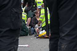"London, February 11th 2015 Teacher Amy Jowett is treated by paramedics after suffering a broken leg on June 1st 2013 during a protest against the BNP who were attempting to march through Westminster to the Cenotaph. She claims she was ""seriously and deliberately assaulted by a police officer who repeatedly stamped on her leg during the protest, suffering ""life-changing injuries"" requiring seven operations as well as therapy to deal with the psychological impact."