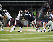 Texas A&M running back Christine Michael (33) is hit by Ole Miss defensive tackle Gilbert Pena (99) in Oxford, Miss. on Saturday, October 6, 2012. Texas A&M won 30-27...