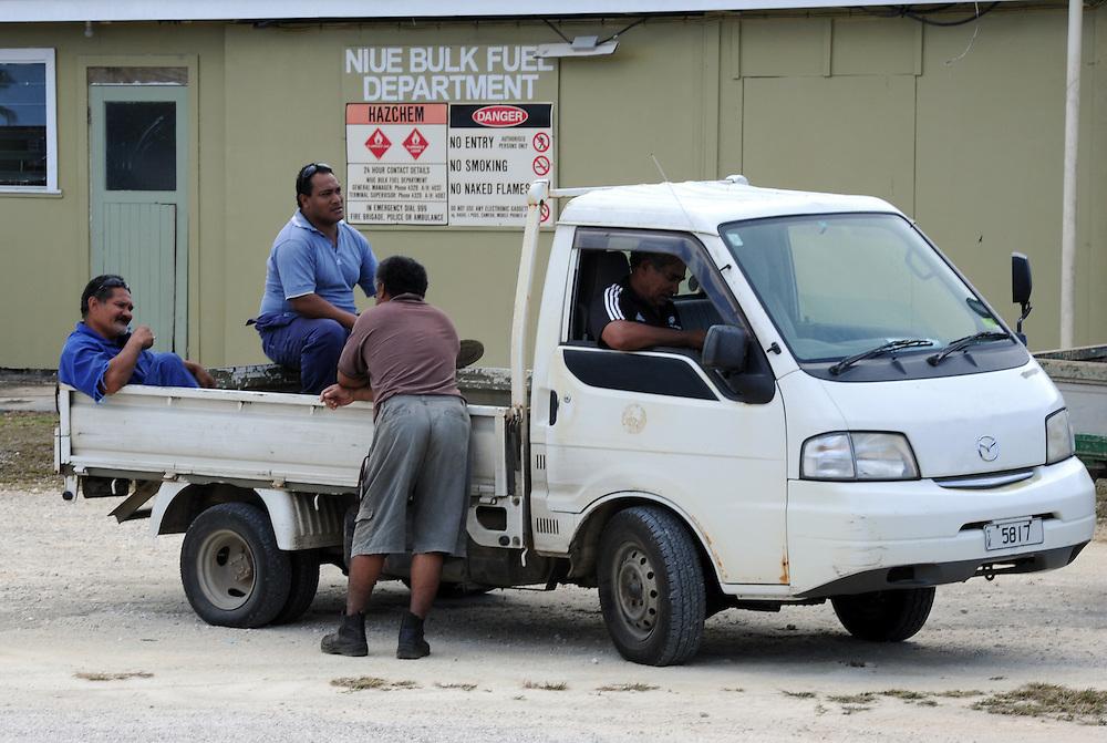 Niuean men at the Alofi International Airport, Pacific Mission 2012, Alofi, Niue, Wednesday, July 25, 2012. Credit:SNPA / Ross Setford