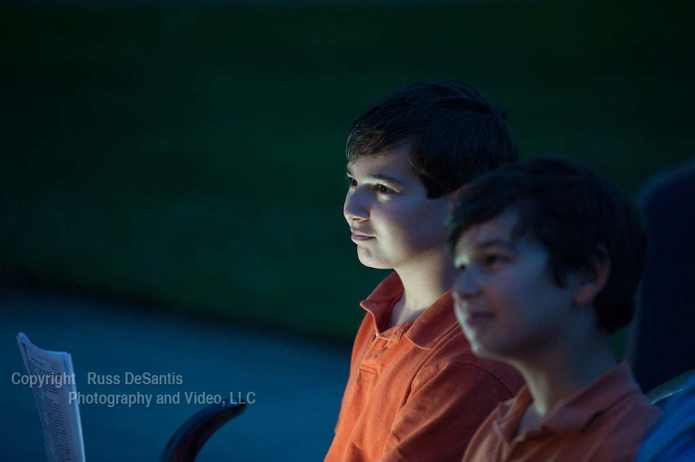 "Zak Dasaro, (LEFT), 12, and his brother Michael, 10, both of Holmdel, listen and learn about the shofar at the first-ever ""shofaron,"" a gathering at the Monmouth Reform Temple in Tinton Falls. The purpose was to learn about and blow the shofar.  - 8/30/11 / Photo by Russ DeSantis for NJJN"