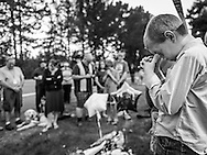 A boy prays during a prayer service in Roseburg, Or., October 4, 2015. Hundreds gathered after Christopher Harper-Mercer, a 26-year-old enrolled at the school, fatally shot an assistant professor and eight students in a classroom of the school.   Photo by Bryan Woolston / for The Daily Mail