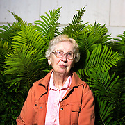 Ruth Wittenwyler, age 82, poses for a portrait outside of her home, which used to be one of only several Limburger cheese factories in Wisconsin. After marrying her husband in the Army, she moved to Wisconsin from her hometown, Chicago, Illinois. The daughter of a banker, she learned to be a farmer's wife through trial and error, Monticello, Wisconsin, May 22, 2006..?It was kind of strange coming up here, being a banker's daughter, yes. We were lucky because we got the first tractor that came into Wixer's machine shop because Harry K (her husband) had been a veteran. We got an International H. I had to drive that darn tractor backwards. I wasn't very marvelous at driving that thing. I couldn't back up in that any better than I can a car. I think that was my worst because I was not very mechanical. I got yelled at a lot.?.-excerpt from interview with Ruth Wittenwyler