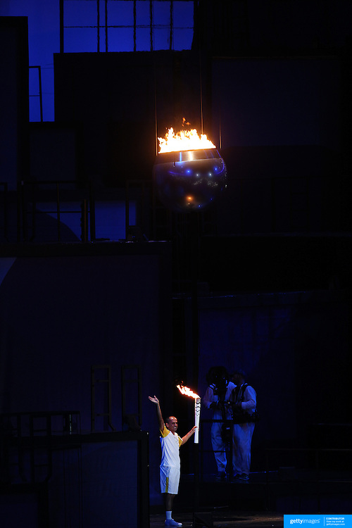 Opening Ceremony 2016 Olympic Games: Vanderlei de Lima lights the Olympic cauldron during the spectacular opening ceremony for the 2016 Olympic Games at Maracana Stadium on August 5, 2016 in Rio de Janeiro, Brazil. (Photo by Tim Clayton/Corbis via Getty Images)